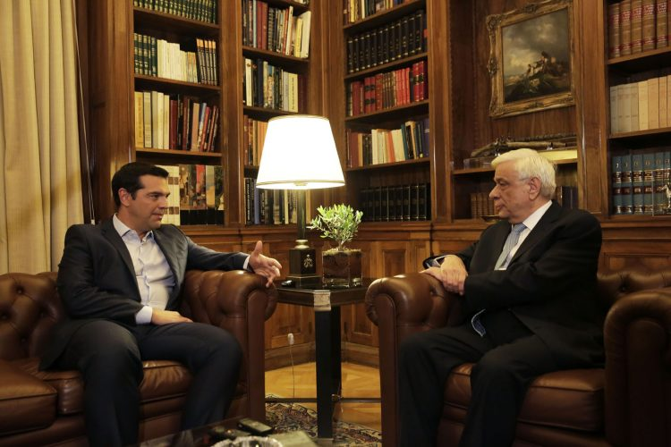 Greek Prime Minister Alexis Tsipras , left, speaks with  Greek President Prokopis Pavlopoulos, during their meeting in Athens, Thursday, Aug. 20, 2015. Tsipras announced his government's resignation and called early elections Thursday, seeking to consolidate his mandate to implement a new three-year international bailout that sparked a rebellion within his radical left Syriza party. (AP Photo/Petros Giannakouris) ORG XMIT: XPG107